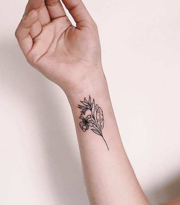 flor tallo hojas antebrazo